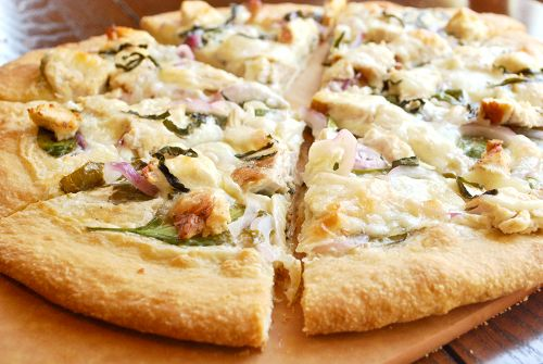 chicken alfredo pizza with spinach and red onions ***good change from the norm. I used my own pizza dough and sauce that I had on hand, and white onions. I would definitely try it with the red though. maybe with some ricotta, too.