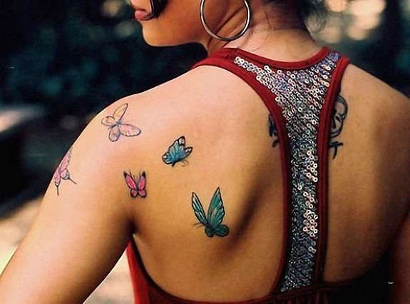 Lifirta Lifi. Butterfly shoulder tattoos. Flock of diversely ...