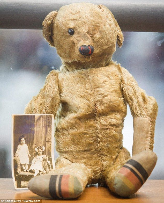 100-year-old antique bear was found at Bristol Airport with a black and white photo.