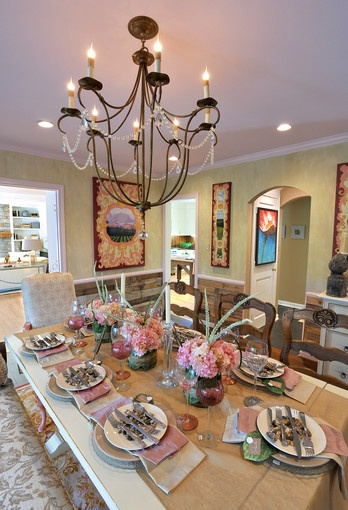 """The """"A La Carte"""" dining room by Paula A. Henry, owner of Simply Put Interiors, has a mix of rustic elements with crystal, silk and antiques."""