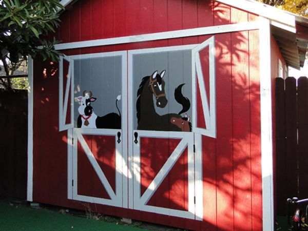 "Any old ugly shed became the highlight of the yard when they painted the shed a barn red, and took one mural, reversed it and repeated it to create the much bigger ""barn doors"". What fun!!"