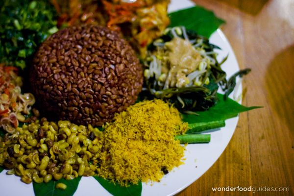 Have you ever tasted Nasi Campur? It's an Indonesian traditional dish that used to be too salty and oily, but not in Bali! Colorful, delicious and so healthy! #bali #indonesia #vegetarian #vegan #food #restaurant