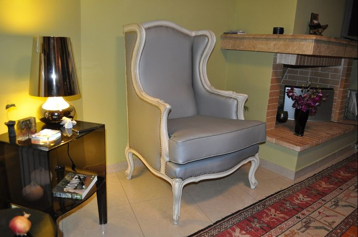 Custom made armchair with matching foot stool, solid wood frame, patina