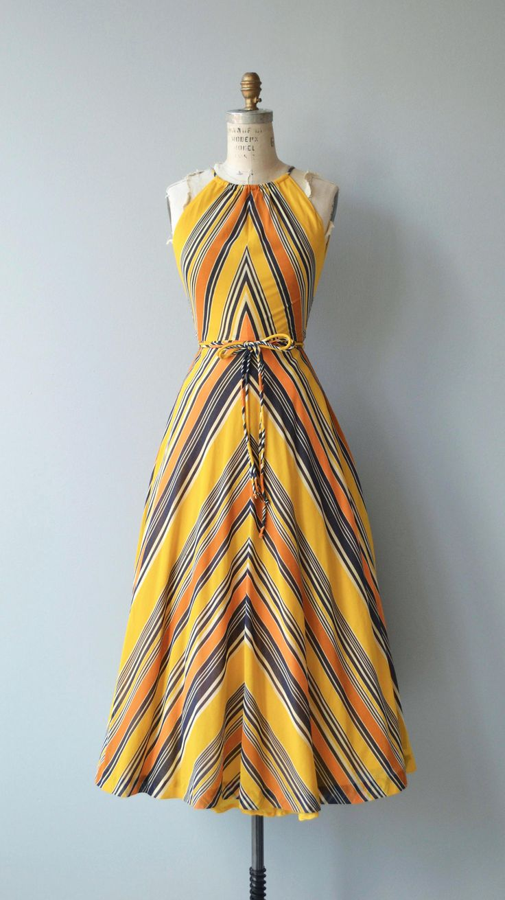 Vintage 1970s cotton dress with chevron stripes, halter neckline, matching tie belt, full skirt and back zipper. --- M E A S U R E M E N T S --- fits like: extra small bust: 34.5 waist: 24 hip: free length: 51.5 brand/maker: Collectors Items condition: excellent to ensure a good fit, please read the sizing guide: http://www.etsy.com/shop/DearGolden/policy ✩ layaway is available for this item ✩ more vintage dresses ✩ http://www.etsy.com/shop&#x2...