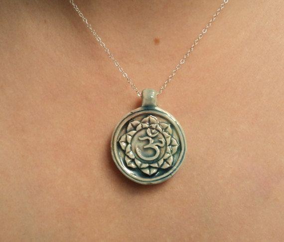 Om lotus flower necklace.  Raku pottery.  blackandwhitejewels via Etsy.