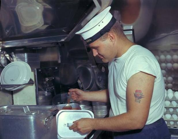 A Royal Canadian Navy cook preparing dinner for the crew aboard ...