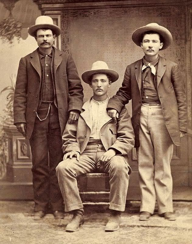 Some cowboys brushed and polished for a studio portrait in the 1890s