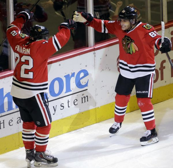 Patrick Kane had a big grin on his face as he skated around the back of the net to congratulate Artemi Panarin on his nifty pass in the third period. The Blackhawks matched a franchise record with their 11th straight victory, using two goals from Jonathan Toews to beat the slumping Montreal Canadiens 5-2 on Sunday. Marian Hossa had an empty-net goal and two assists for Chicago, and Kane had a goal and an assist.