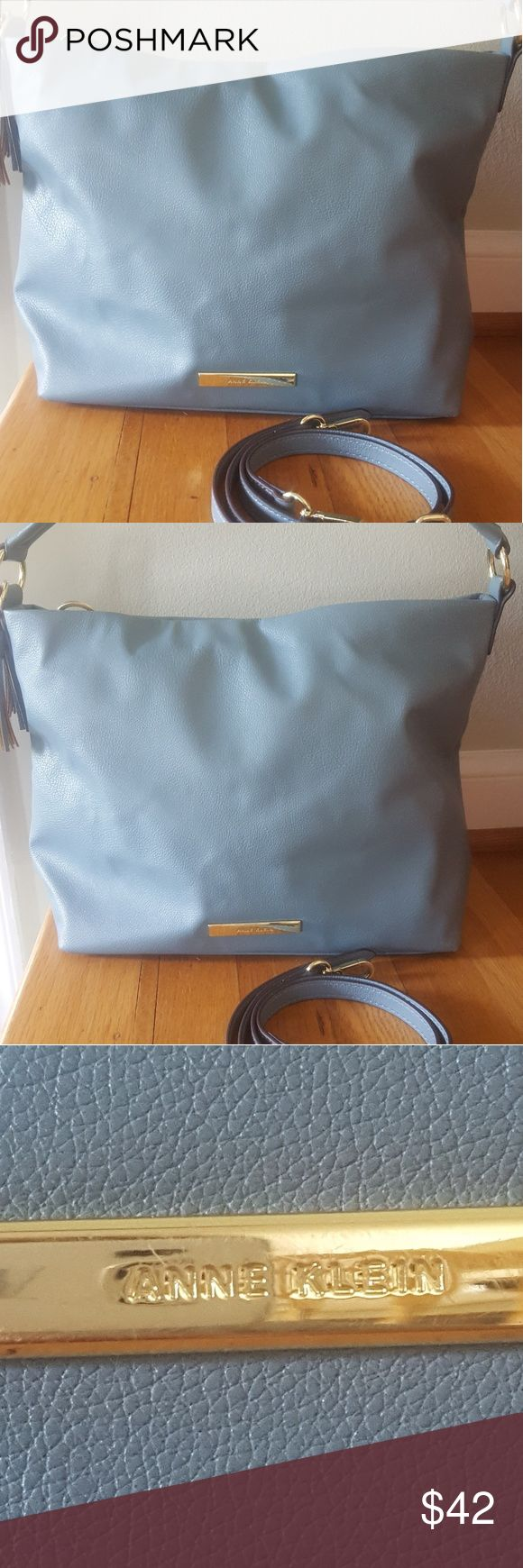 """ANNE KLEIN PALE BLUE HANDBAG TOP ZIPPER This bag is very good condition. The name tag has minor rub mark but overall great shape.  Very nice pale blue handbag/shoulder bag. Shoulder bag strap,is included.  Inside is navy and white polka dot lining. Also 1 zip pocket and 2 slots for phone keys, etc.  Measure14"""" x 10"""" x 5""""  Should strap drop is 7"""" Additional strap drop is adjustable approx. 18"""" Anne Klein Bags Shoulder Bags"""