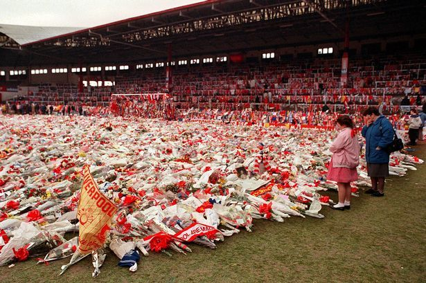 Flowers, wreaths and tributes left on Liverpools Anfield stadium pitch in memory of the 96 soccer fans who died in the hillsborough disaster