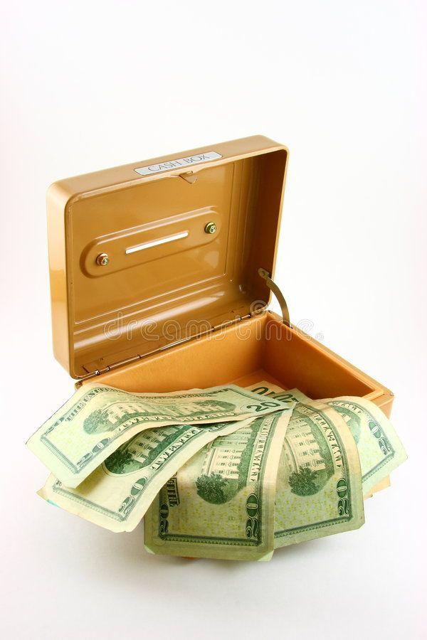 Dollars in open cash box. Twenty dollar bills in o…