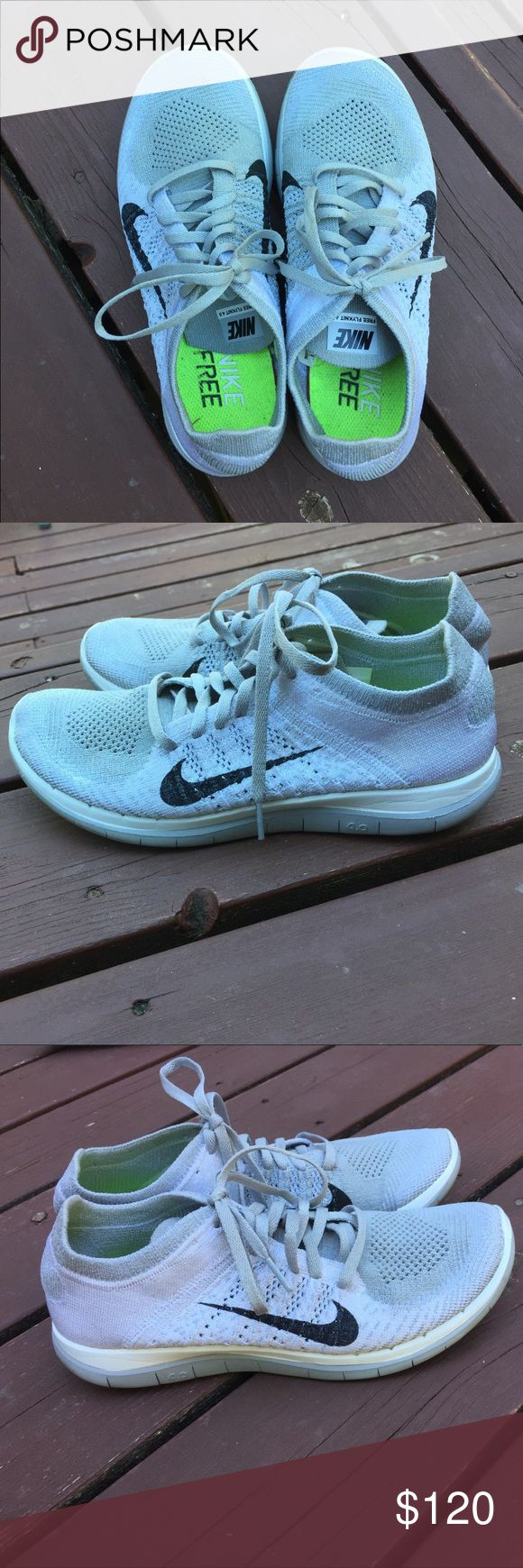 White and gray Oreo Nike free flyknits Firm price. Very gently worn. No scuffs or chipping and In excellent condition! Very hard to find in this size/color combination. **the colors are white and light gray Nike Shoes Athletic Shoes