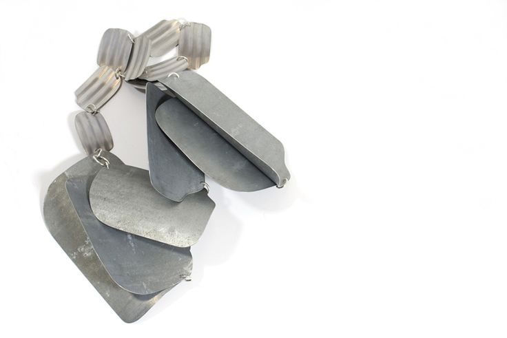 """JULIE CONNELLAN -IRELAND Jewellery  Zinc, Iron, Tin, Silver  Dublin 2012 """"Ravary's Roof  _  At Ravary, old roof tiles are stacked neatly in rows. Other broken ones have been gathered in large piles. The necklace is based on these shapes. Ravary's old roof has become wearable.  Necklace """""""