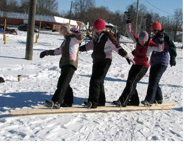 Make a 6 or 8 legged ski race with a 2x4 and some rope.  Eric will need to help me with this one.