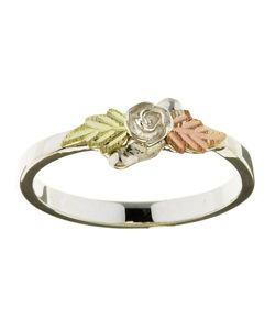 Floral and feminine, this gorgeous Black Hills Gold rose ring is a delicate accent for any occasion. The central sterling silver rose is surrounded by two leaves in 14k green and pink gold, showcasing