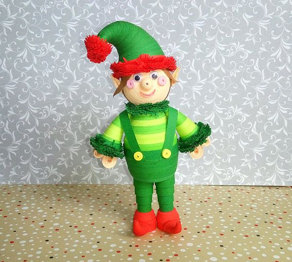 100 % handmade  - The size of toys: height 16 cm (6.30), width 9 cm (3.54) and 5 cm (1.97) long - For work were used paper strips width of 7, 3 and 1.5 mm - Christmas Elf very cute, funny and beautiful. The work was done carefully. - Paper toy beautifully decorate your home for the Christmas holidays. Also, it will serve as a perfect gift on the eve of the Christmas holidays. - Keep the toy need from water and dust.  - Thank you for visiting our store