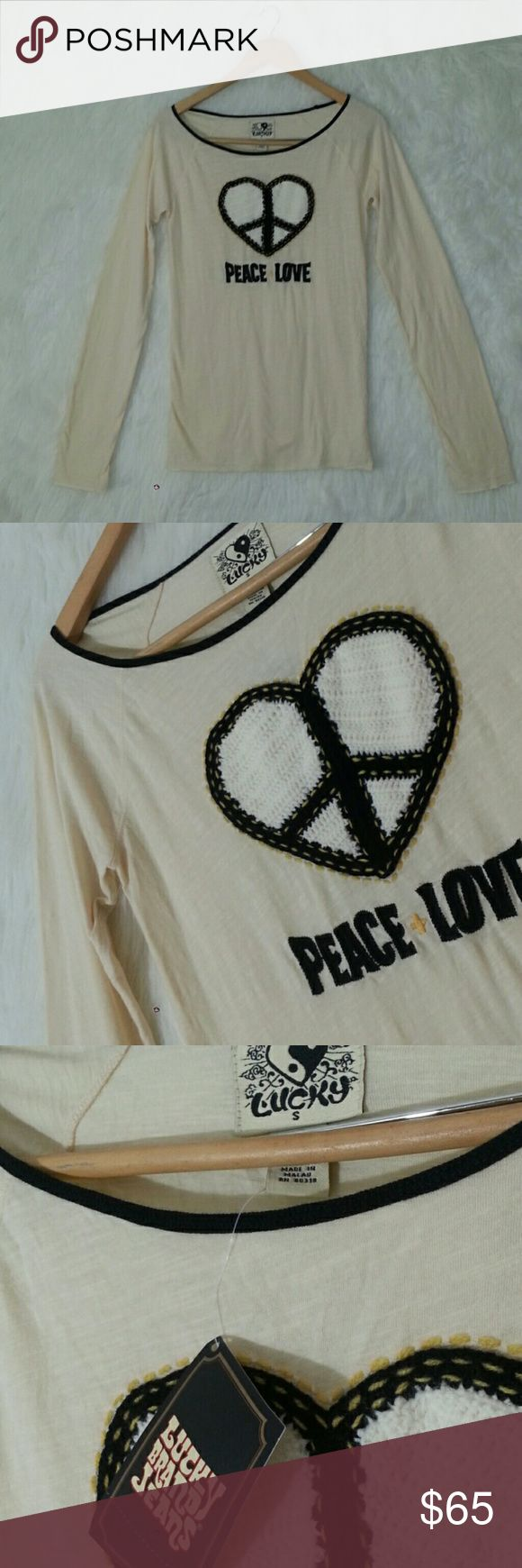 "{ LUCKY Brand } Crochet Heart Peace Love Top - NEW Our household includes a military veteran with cancer. Please respect our time!  ***NO TRADES WHATSOEVER*** <<< Reasonable offers welcome >>> All items available for purchase unless it says SOLD or NOT FOR SALE.  RARE! Cream long sleeve top with crocheted heart applique and PEACE + LOVE embroidery. 100% cotton.  Light weight. The back is plain. SMALL...Bust is 33"". Top is 26"" long...BRAND NEW, NEVER WORN WITH ORIGINAL TAGS.   I work in L.A…"