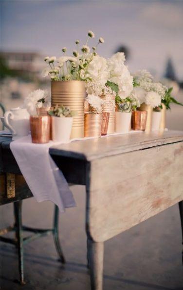 copper sprayed flower displays - a mix of vintage and industrial #weddingtrends2016 #copperwedding
