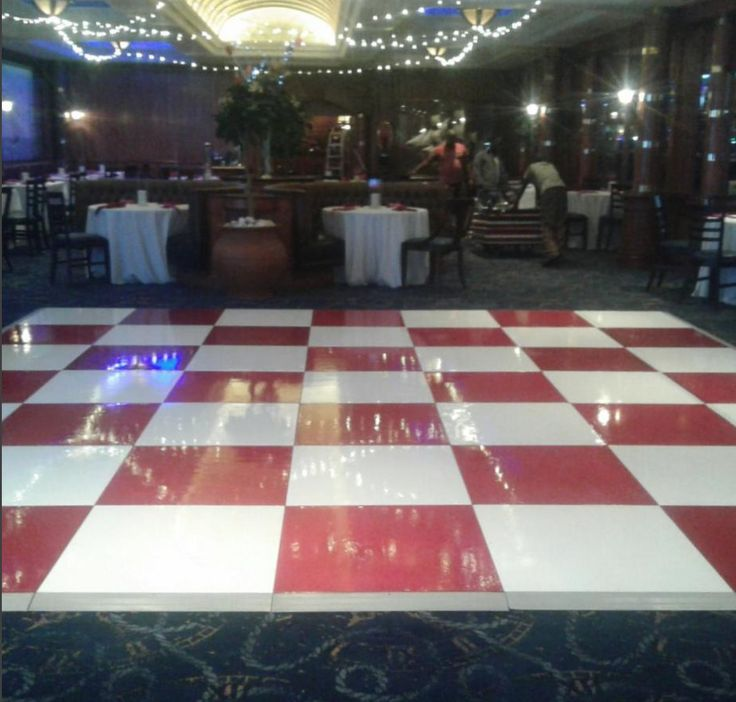A racy red and white check painted dance floor ready to sparkle and shine #connectafloorcape #eventflooringcape town