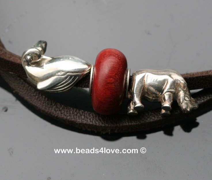 Pink Ivory bead (Tree Wood Studio) together with the Whale and the Rhino from Wild-Beads on a leather bracelet.