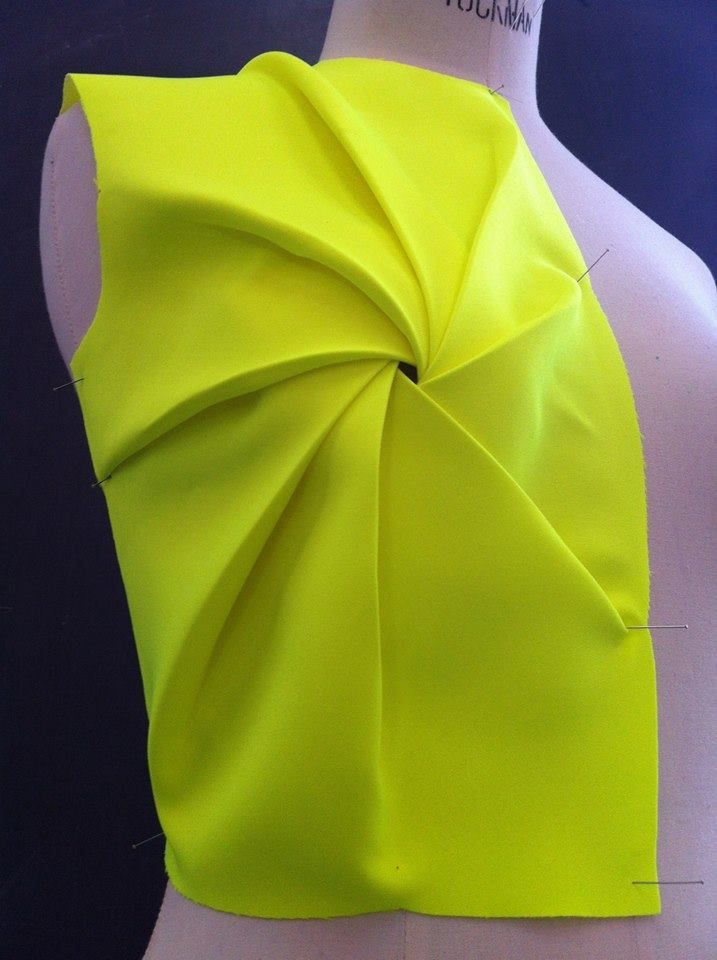 Sunray effect tucks/pleats around the bust apex.