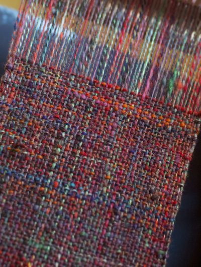 Variegated homespun, handwoven on a simple two-shaft loom.  I love this!: