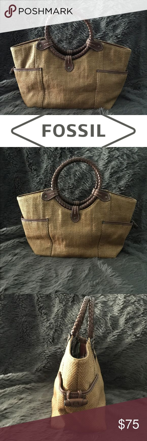 """Fossil Straw Tote Gorgeous EUC Fossil Straw and Leather Tote. Features 2 slip pockets on each exterior side.  Snap closure opens to reveal 2 large compartments divided by a large zip Top closure compartment.  In addition there is 1 interior zip pocket and 2 slip pockets, on adjacent sides.  Approximate size 15""""L x 5""""W x 9""""H with 5.5"""" circular hand hold. Fossil Bags Totes"""