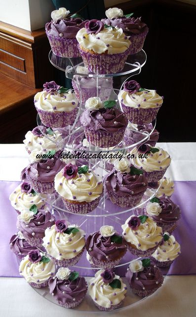 Cream and purple cupcakes - http://www.thevanillavalley.co.uk/round-cupcake-stands/round-cup-cake-stand.html