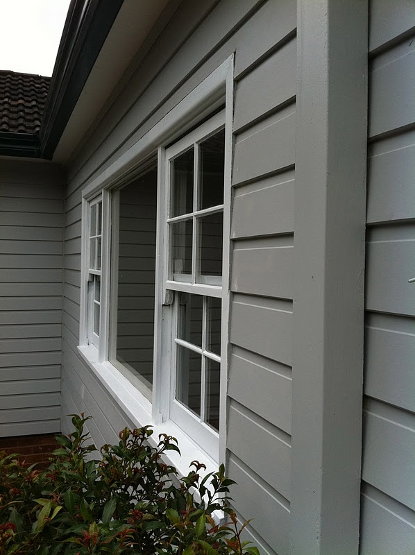 These weatherboards  Dulux Milton Moon with Dulux Domino front door and gutters