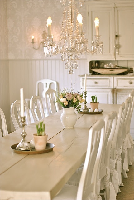 farm table, crystal chandelier and wallpaper