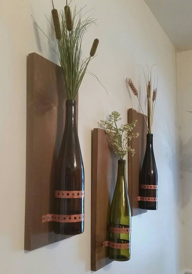 17 best images about old glass bottles on pinterest for Wall decor wine bottles