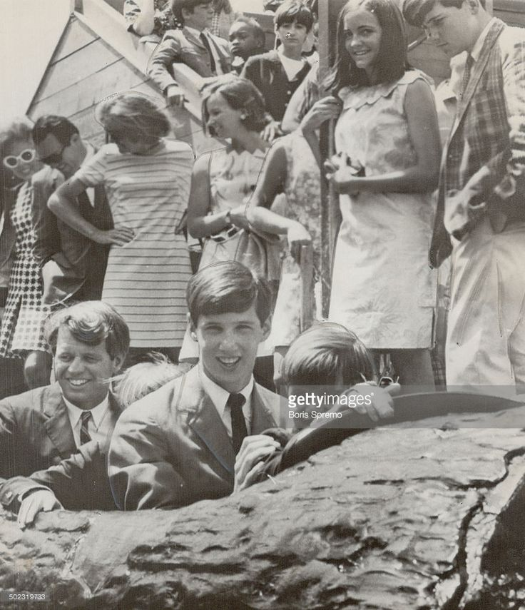 Eight Kennedys invade expo. Senator Robert Kennedy (bottom left) and two sons ard log ride in La Ronde amusement area of Expo as Mrs. Kennedy (centre; holding sunglasses) and girls await their turn. Parents and six Kennedy children postponed visits to pavilions in favor of La Ronde rides after Kathleen; 16; said she felt sick in Labyrinth, 1967.