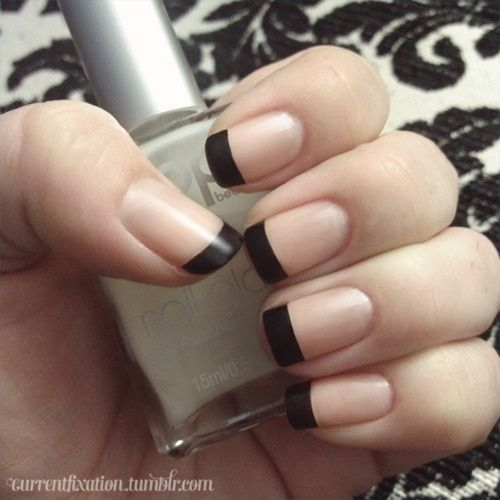 matte black french manicure. I love how clean this looks. Too often I see women over-do black nail polish, to the point where it looks trashy. This look is refined and crisp. I approve.