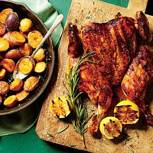 """The """"top-shelf"""" in this recipe speaks to the crispy skin, superior flavor, and juiciness of the bird. It also refers to a novel new technique: cooking potatoes in the heavy cast-iron skillet that's used as a weight on the chicken. The weight presses the chicken flat against the grill grates, cutting the cooking time in half. Plus you'll be cooking your side dish at the same time."""