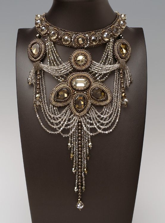 Long Necklaces:  Beads, crystals, lots of strings, some weaving and you have this Art Deco long necklace.  With the more simple line fashions of the era, a necklace like this could really stand out without clashing with ruffles, bows, etc.This one would be fun to make!