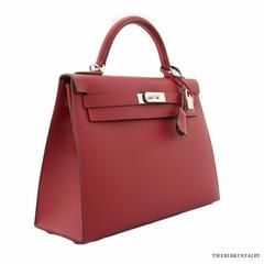 NEW! Hermes 32cm Rouge Grenat Sellier Kelly Bag w/ Palladium. A true symbol of luxury, this Kelly handbag bag has a rich pomegranate color that's perfect for the fall. Made from Epsom leather, this bold handbag makes it easy to make a statement no matter where you go. #TheBirkinFairy, #Hermes, #Leather, #Fall, #Handbag