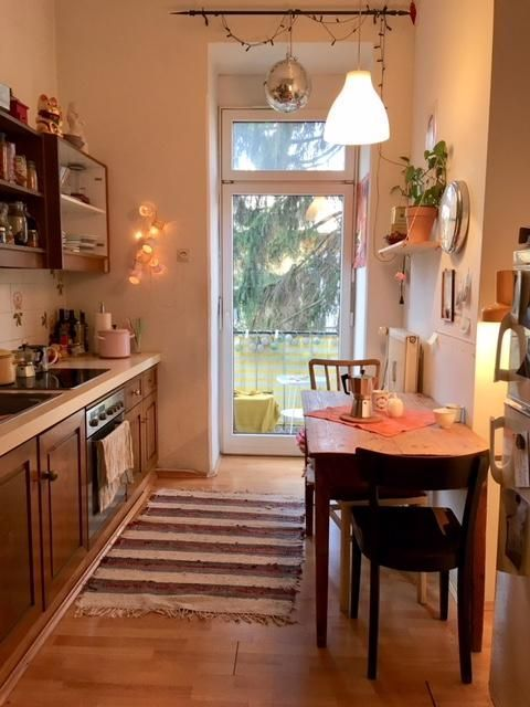 Cozy kitchen with fairy lights and balcony access. # Setup #interior #k