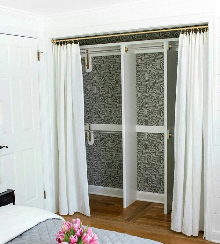 Open Wardrobe With Curtains.