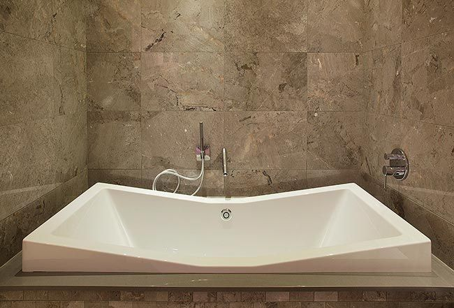 Large double ended bathtub in the TileStyle Bathroom Showroom
