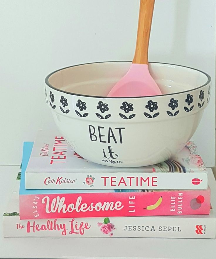 Mixing bowl from creative bake. This bowl is beautifully crafted in stoneware in gorgeous tones of ivory and black, Mix, fold and stir ingredients in this charming bowl with a quirky 'beat it' motif and dainty floral detail, sketched in a hand drawn style.