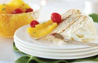 White chocolate and Grand Marnier cake with orange and raspberry macedoine