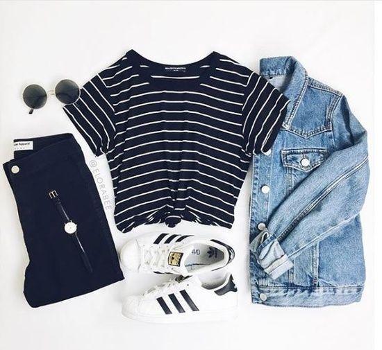 Faded denim jacket, black striped T-shirt, black skinny jeans, white adidas tennis