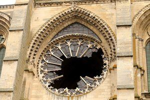 The broken stained-glass rose window of the gothic cathedral in Soissons, France, following an overnight storm