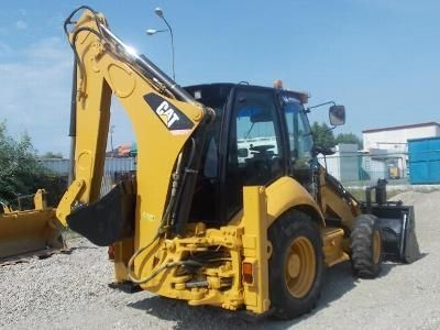Buldoexcavator second hand CAT 428E - Bergerat Monnoyeur Romania