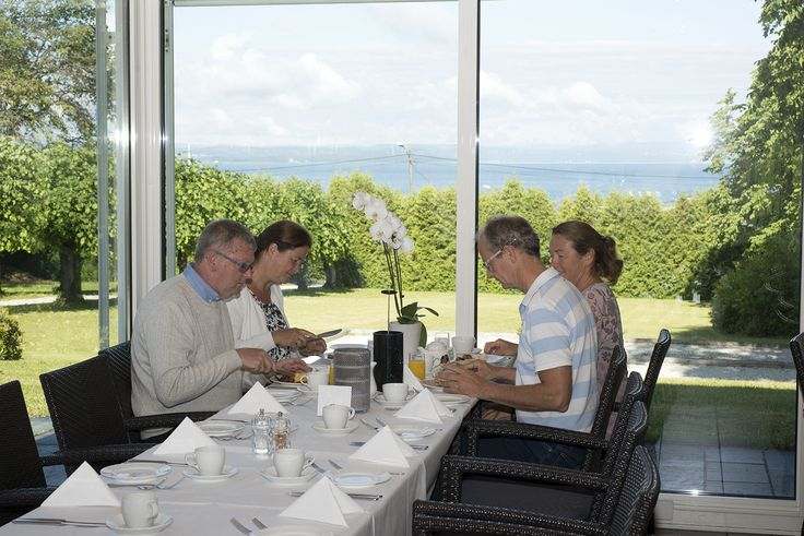 Enjoy a lovely breakfast in our beautiful pavilion. Fjordview, the Oslofjord, fantastic breakfast view, good morning, summer, spring, fall and winter, glasshouse, morning view. Hotel Refsnes Gods.