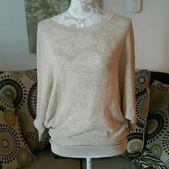 Express shimmer gold batwing top Long top beautiful for spring. Creamy tan with a hint of gold shimmer. 3/4 batwing sleeves. Pair with for favorite comfy white tank. Express Sweaters Shrugs & Ponchos