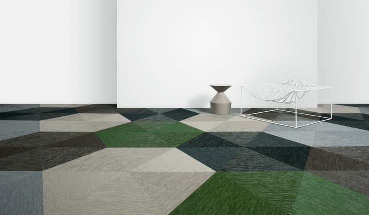 Botanic Triangle Tiles Swedish Bolon company makes modern rug inspired flooring out of plastic material that is designed for heavy use.