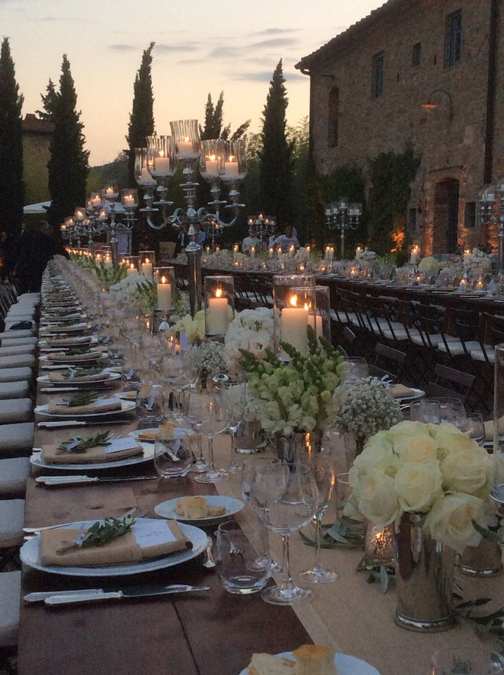 Rustic Tuscan table arrangements at sunset in the Tuscan countryside. All Rights Reserved GUIDI LENCI www.guidilenci.com