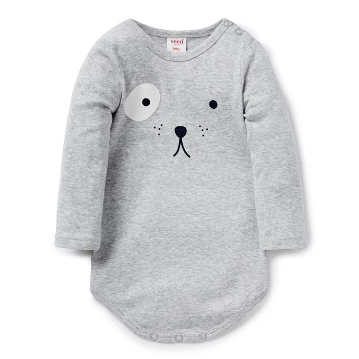 100% Cotton Bodysuit. Long sleeve bodysuit, features novelty animal face print on front. Regular fitting silhouette with snaps on baby's left shoudler for easy dressing. Available in Fog Grey Marle and Canvas.