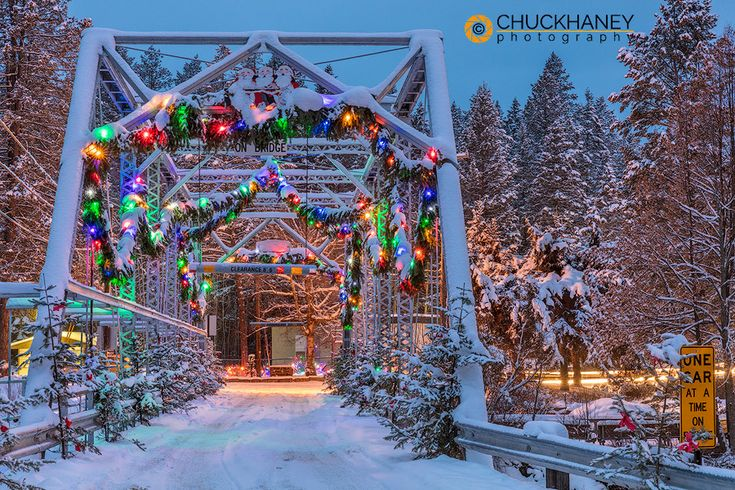 Christmas decorations adorn the historic one lane Swan River Bridge in Bigfork, Montana.